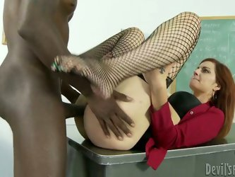 Horny teacher spreads her legs all dressed in fishnet stockings and gets her sweet pussy fucked hard in missionary pose. Later he fucks her from behin