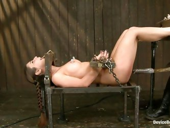 Laid on a table and immobilized in bondage devices Serena receives a hard punishment. Her cute tits are tortured with small suckers and her shaved cun