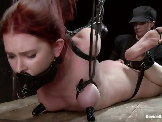 Chastity is a fucking slut. She has been tied up and laid on her belly on that wooden table. The mistress works hard at her shaved pink cunt with a di