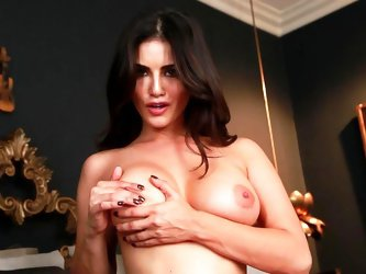 This is a very horny milf. Those nice natural breasts she is squeezing, hot legs and dark hair are making us horny. She's a slut and spreads her