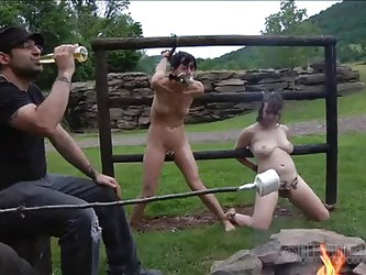Why not have a beer and a marshmallow while these whores stay tied on the fence. The bitches are completely naked and it's a bit cold outside. Pe