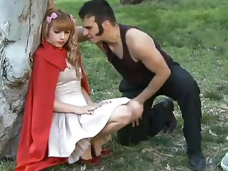 Little red riding hood is sIeeping on the grass. The big bad wolf approaches her and demands her innocence. She wants to go back home to save her gran