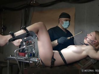 Tied on the gynecologist table Ashley lives a nightmare! The insane doc has perverted thoughts with her and he puts them to action. He gaped Ashley