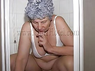 Hot old lady Rosa climbs in the shower cabin and is eager to piss. After finishing pissing, she turns on the shower and starts cleaning herself a litt