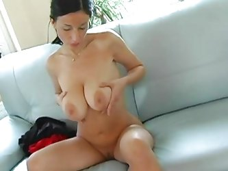 Brenda strips naked for you and rubs her pussy and tits. She pushes her boobs together so you can get a much better view of them. She bounces her boob