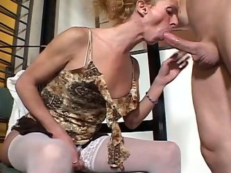 Dirty bitch with fake tits is sitting down on her knees stroking her dick while giving head. She then licks dude's ass hole.