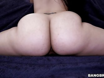 This beautiful, dark-haired slut shows off her thick and juicy ass. She spreads open her cheeks really wide for a nice view of her crack. Her man kiss