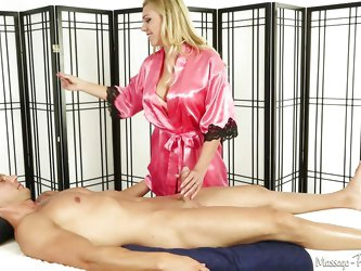 This lovely lady is ready for some hot action. When her client comes in, she gives him a massage, but things soon get even naughtier. She is wrapping