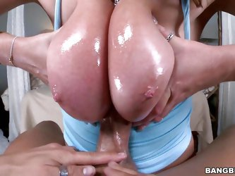This sexy hot blonde babe has a cock so deep in her mouth, that she is choking on it and coughing up slobber, and spit all over it. She wraps her oile