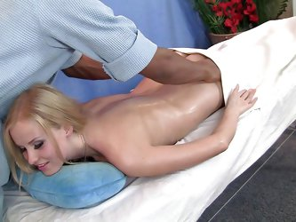 She is blonde, oiled up and gorgeous. Her big bubble butt is milky white and gets oiled up by the masseur. With such a beauty in front of him he barel