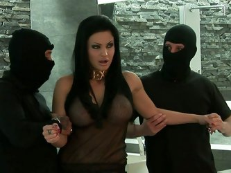 Couple of nasty masked dudes seduce stunning busty hoe Aletta Ocean for a quickie! Neat brunette bitch takes it up her ass while sucking on massive pr