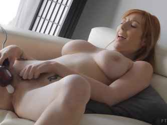 Gorgeous redhead MILF Lauren masturbates until she reaches orgasm