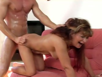Luscious mature mommy is riding hard stick of young stud in reverse cowgirl position. Then she stands on her all four getting hammered bad in her twat