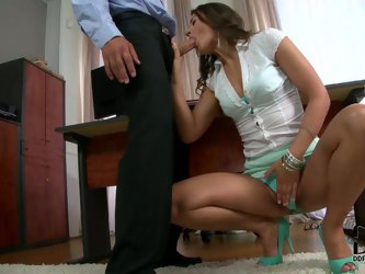 She is very impressed with her partner's dick. She takes it in her lustful mouth and sucks it greedily. Then she spreads her legs wide to let him