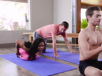 Bored black girl starts to flirt with another student during yoga lesson. Strict teacher catches them up and decides to team up with disciple to doubl