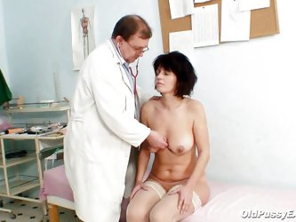 Mature lady with big tits is in doctor's clinic for her pussy to be examined. Firstly her eyes are checked then her boobs are examined by the doc