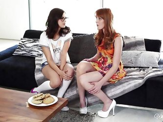 This pair of hot bitches are chatting on the couch, and you can sense the sexual tension between them. It isn't long before, Marie and Shyla are