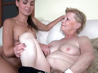 This granny is one filthy whore! She spreads her legs wide and lets her lesbian friend finger her pussy. Press play and enjoy the show!