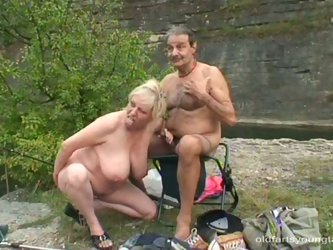 Rapacious fat daddy is watching a curvy blond hussy taking sunbath topless while his chubby wifey approaches to give him a head. Later slutty blond jo