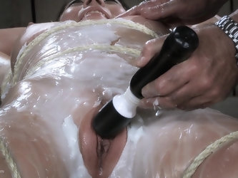 Hot tied up Asian babe screams while enjoying hot wax play