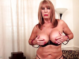 Rae has her tits out and she plays with them, for you. The sight of her amazing natural boobs is quite a spectacle. The dirty girl moves her hands dow