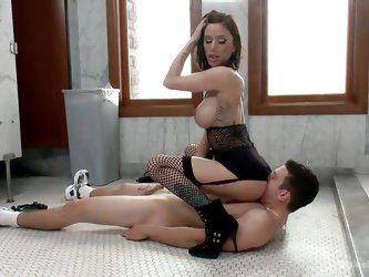 This little slave boy is laying on the bathroom floor like a dirty slut. His mistress spreads her legs apart and sticks a big black strapon up his tig