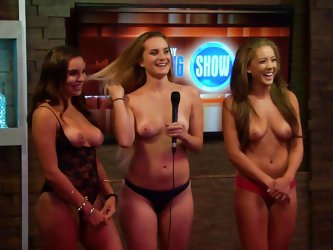 Nat Faxon is on the playboy morning show talking with the hosts. Three sexy girls show off their sexy bodies to the guest and morning host. They have