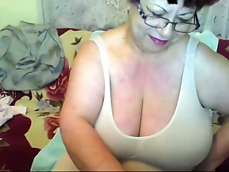 A short-haired mom gave me a private webcam show. She stripped and demonstrated her butt and holes, then kneaded her big natural jugs.