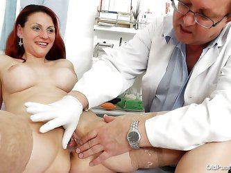 Early in the morning, a mature redhead has her appointment to see the gynecologist. The doctor closely examines her body, following exact steps: he ta