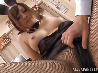The Japanese honey in the video is wearing a ribbon and a rabbit ears, while being dressed up in a kinky costume, with fishnet stockings. Watch her lu