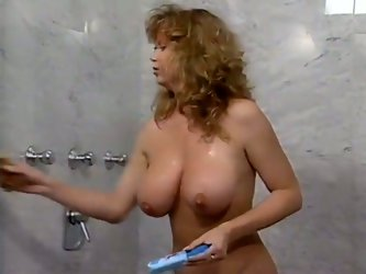 Watch this hot and kinky babe touching herself and rubbing her wet and tight pussy while taking a shower in her bathroom.