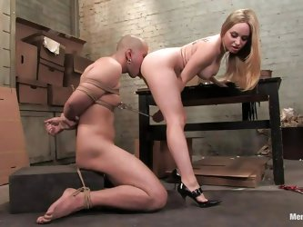 She tied him and with the help of some clamps now she's torturing his dick while taking care of his self esteem. Look at her how bossy she is, ma