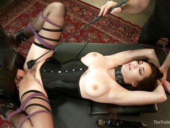 This kinky little sex slave has her pussy ready to take her executor's big cock. The master's helper takes a whip and slaps her pubis area t