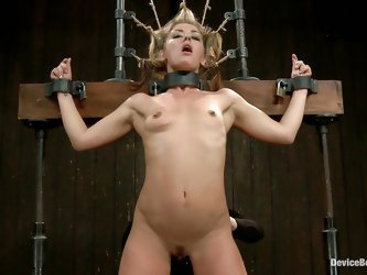 Cute blonde Sheena Shaw is tied up real hard on that bondage device. She get's her hairy pussy fingerd from behind and then the women inserts a t