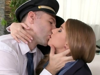 A dude removes his uniform fuck a hot stewardess in living room