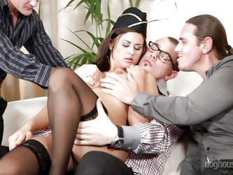 This stewardess gets gang banged by four horny men. She takes turns sucking all their cocks and she loves it. The stewardess gets her pussy eaten and