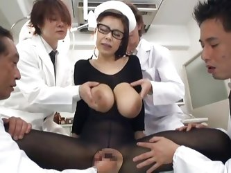 She is in the middle of attention and loves it. All those doctors are inspecting her and cut a hole between her sexy thighs to have access to her cunt