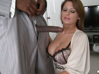 Attractive MILF with juicy boobs, wonderful legs gets on her knees and starts sucking on that black dick. She takes her bra off and seems prepared to