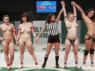 Watch these four naked chicks wrestling with each other to win the chance of having a dominating lesbian fuck. With grappling and fingering the blue t