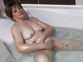 Watch this horny 70 years old lady masturbating all alone while taking a bath. She is all naked, showing her chubby body and saggy tits. And in the tu