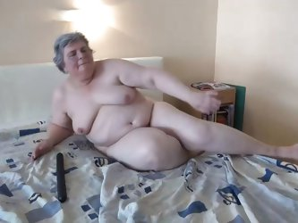 This chubby old women's lust did not fade out with her age. She still desires for a good masturbation. She is already undressed and her big boobs