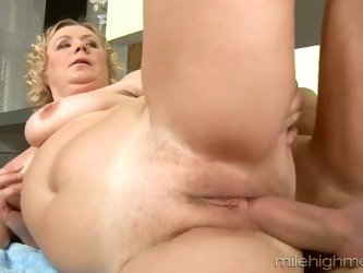 Lustful granny with chunky body fucks doggystyle with young dude