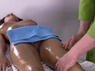 Two large boobs are getting groped and massaged on the massage table