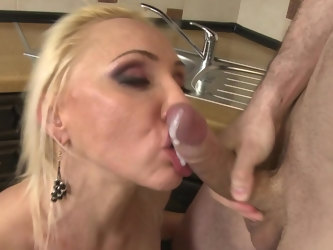 Blonde wife Hot Doll Iris takes a dick from behind in the kitchen