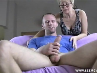 Fat dick in hands and mouth of a mature blonde makes him cum