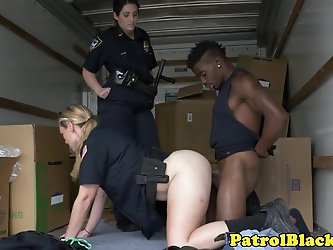 Femdom cops fuck black dude in back of truck