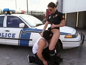Large dude is pushing his cock into a sexy cop with large tits