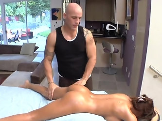 Slim goddess with round boobs lies on massage table and enjoys massage from bald specialist. He gently touches oiled up tight body and pussy until rel