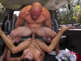 Cute girl in the van is flexible as she gets fucked by a big dick