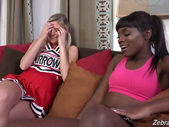 Interracial cheerleaders strip off their uniforms and have lesbian sex
